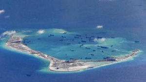 Chinese dredging vessels are purportedly seen in the waters around Mischief Reef in the disputed Spratly Islands in the South China Sea in this still image from video taken by a P-8A Poseidon surveillance aircraft provided by the United States Navy May 21, 2015.  U.S. Navy/Handout via Reuters/File Photo/Files