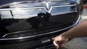 The radar technology of a Tesla Model S containing Autopilot features is pointed out during a Tesla event in Palo Alto, California, U.S., October 14, 2015.  REUTERS/Beck Diefenbach/Files