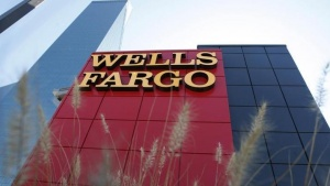 A Wells Fargo bank is pictured in Dallas, Texas October 9, 2008. Shares of Wachovia Corp slumped about 16 percent on concern talks to divvy up the troubled bank had hit a snag, leading a broader drop in U.S. regional banks. Wachovia shares, as well as those of competing buyers Wells Fargo & Co and Citigroup Inc, dropped after the Wall Street Journal reported talks between the three about potentially splitting Wachovia were hung up on several issues. REUTERS/Jessica Rinaldi