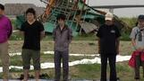 Japan marks disasters six months on