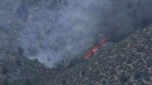 Battle to contain Arizona wildfire