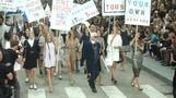 "Chic ""protesters"" take Boulevard Chanel at Paris Fashion Week"