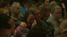 Vigil marked by tears, grief after Washington sta