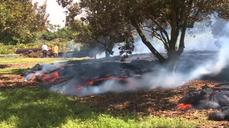 Hawaii lava flow hits property, threatens dozens more