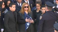 Widow of slain NYPD officer receives his burial flag