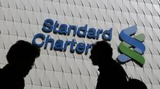 StanChart makes steep cuts