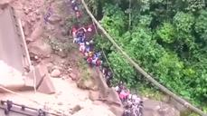 Bridge collapses due to flooding in Bolivia