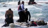 Migrants rescued as boat runs aground off Greek island