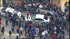 Protesters smash cars, face-off with Baltimore police
