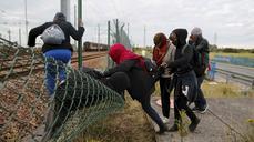 Migrants describe Calais camp hell