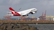 Qantas flies back into the black