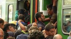 Chaos on tracks as Hungary stops migrant train