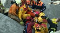 Signs of life in Taiwan as eight-year old is pulled from rubble