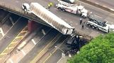 Truck dangles off Bronx overpass