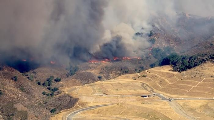 Hundreds evacuated from path of wildfires in California