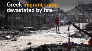 Fire burns through Greek migrant camp