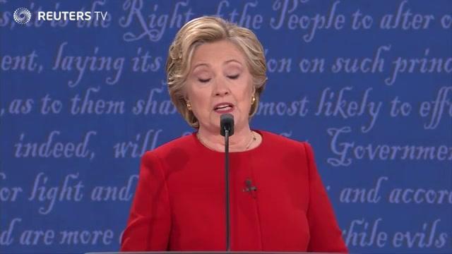 美国总统候选人首场辩论唇枪舌剑
