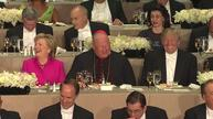 Separated by a cardinal, Trump and Clinton sit down to dinner