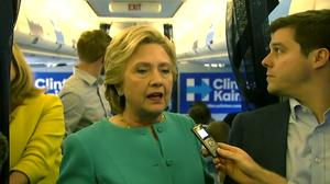 Clinton voices concern about AT&T-Time Warner deal