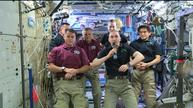 Hugs aboard space station after change of command