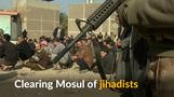 Iraqi forces screen Mosul men in hunt for suicide bombers