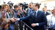 Macron gladly greets supporters after winning first round in France's presidential race