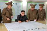 North Korea holds off on Guam plan