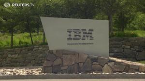 IBM powers Dow to first close above 23,000