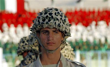 A Kurdish Peshmerga soldier attends a graduation ceremony at a stadium north of Baghdad, October 25, 2005. When U.S. and Iraqi forces step up an offensive against militants in Baghdad, 4,000 Kurdish soldiers will be there on the frontlines, taking part in their first major operation under Iraq's new army. REUTERS/Azad Lashkari