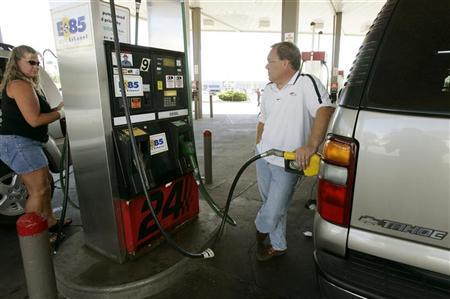 In this file photo a man fills his 2002 Chevrolet Tahoe with E85 fuel, a blend of 85% denatured ethanol and gasoline at a gas station in Greeley, Colorado July 7, 2006. REUTERS/Rick Wilking
