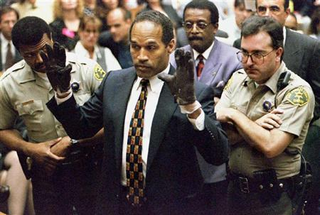 O.J. Simpson holds up his hands to the jury wearing the infamous gloves found at the crime scene and his home in this June 15, 1995 file photo. Attorneys for the father of murder victim Ron Goldman subpoenaed several Hollywood industry groups on Monday, seeking money O.J. Simpson was paid for TV appearances and work in such movies as ''Naked Gun 33 and 1/3'' and ''The Towering Inferno.'' REUTERS/Sam Mircovich/Files