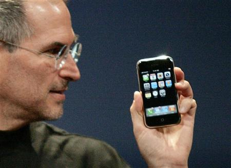 Apple CEO Steve Jobs holds the iPhone in San Francisco, January 9, 2007. Cisco and Apple said on Wednesday they had reached an agreement that allows both to use the ''iPhone'' name, after Cisco sued the iPod maker for using it for a new multimedia phone. REUTERS/Kimberly White