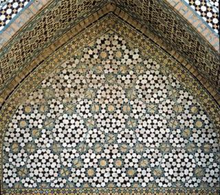 "Medieval Islamic artisans developed a pattern-making process for designing ornate tiled surfaces that allowed them to produce sophisticated patterns not seen in the West until centuries later, a new study suggests. Many walls of medieval Islamic buildings have ornate geometric star-and-polygon, or ""girih,"" patterns, often overlaid with a zig-zagging network of lines. This undated picture shows an archway from the Darb-i Imam shrine, Isfahan, Iran ( built in 1453 ) with two overlapping girih patterns. REUTERS/handout/K. Dudley and M. Elliff."
