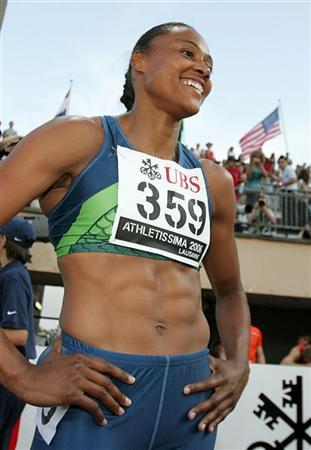 Marion Jones of the U.S. smiles after winning the women's 100-metre race at the IAAF Super Grand Prix athletics meeting in Lausanne in this file photo from July 11, 2006. REUTERS/ARC/Dominic Favre