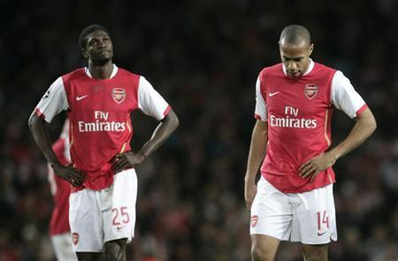 Arsenal's Thierry Henry (R) and Emmanuel Adebayor react after their Champions League match against PSV Eindhoven at the Emirates Stadium on March 7 2007 . REUTERS/Eddie Keogh (BRITAIN)