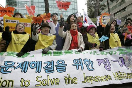 Former South Korean comfort women, who were forced to become sex slaves by Japanese soldiers during World War II, chant anti-Japanese slogans at a protest in front of the Japanese embassy in Seoul March 7, 2007. Prime Minister Shinzo Abe sought on Sunday to contain fallout from his remarks about women forced to act as wartime sex slaves for Japanese soldiers as the furore threatened to cloud summits with Chinese and U.S. leaders. REUTERS/You Sung-Ho