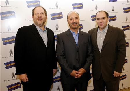 Harvey Weinstein (R), Blockbuster Chairman, and Chief Executive John Antioco (C) and Bob Weinstien arrive for a news conference in New York November 15, 2006 file photo. The Weinstein brothers have partnered with investment firm Hilco Consumer Capital to buy the Halston fashion brand, which was favored by the international jet set during the 1960s and '70s. REUTERS/Brendan McDermid