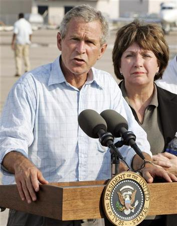 In this file photo, U.S. President George W. Bush (L) makes a statement beside Louisiana's Democratic Gov. Kathleen Babineaux Blanco after touring Hurricane Katrina damage in New Orleans, Louisiana, September 2, 2005. Blanco, whose approval ratings have fallen during the state's difficult recovery from Hurricane Katrina, said on Tuesday she will not seek reelection this fall. REUTERS/Larry Downing