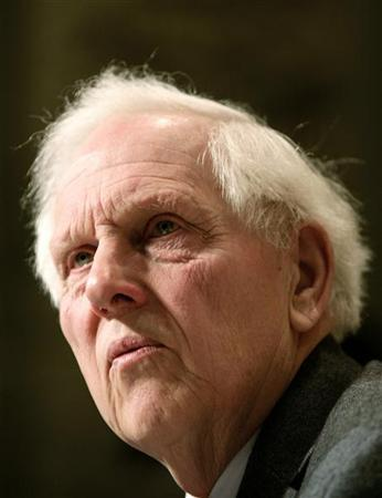 A file photo of former hostage Norman Kember listening to a question during a news conference in central London December 8, 2006. REUTERS/Dylan Martinez