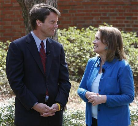 U.S. presidential candidate John Edwards (L) and wife Elizabeth look at each other during a news conference held to address Elizabeth's ongoing battle with cancer in Chapel Hill, North Carolina March 22, 2007. REUTERS/Ellen Ozier