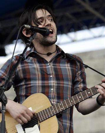 Conor Oberst of Bright Eyes performs at the Newport Folk Festival in Newport, Rhode Island in this August 7, 2005 file photo. REUTERS/Brian Snyde