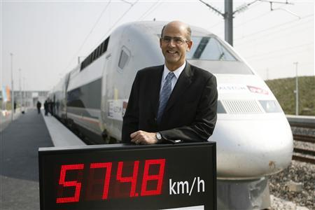 Patrick Kron, chairman and chief executive of Alstom, poses in front of the special V150 French TGV high-speed train after it set a world speed record at 574.8 km (357 miles) per hour in France's Champagne region at Bezannes, eastern France April 3, 2007. REUTERS/Charles Platiau