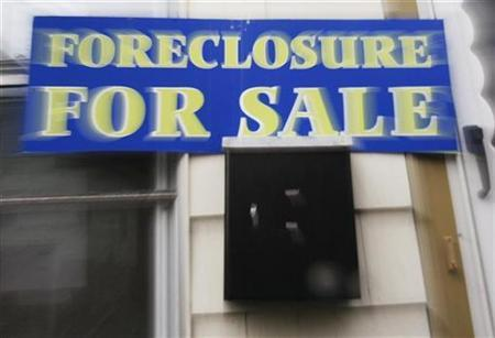 A sign reading ''Foreclosure For Sale'' is posted on a house in the Boston suburb of Dedham, Massachusetts in this file photo from March 15, 2007. The largest U.S. banks sold expensive subprime loans more frequently to minorities than whites, according to a study released Wednesday by a community activist group. REUTERS/Brian Snyder
