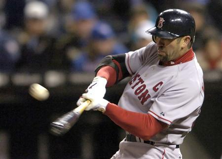 Boston Red Sox Jason Varitek hits a sacrifice fly to score Manny Ramirez in the sixth inning against the Kansas City Royals during their American League baseball game in Kansas City, April 4, 2007. REUTERS/Dave Kaup