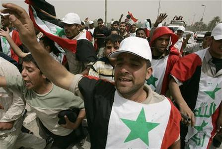 Demonstrators chant slogans in Najaf, 160 km (100 miles) south of Baghdad, April 8, 2007, in preparation for the fourth anniversary of the U.S.-led invasion of Iraq. REUTERS/Ceerwan Aziz