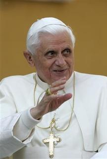 Pope Benedict XVI waves as he arrives at his weekly general audience in Saint Peter's square at the Vatican April 11, 2007. Pope Benedict has written a book called ''Jesus of Nazareth'' where he presents his view of the person of Jesus Christ, who Christians believe was the son of God who became man, died and rose from the dead. REUTERS/Dario Pignatelli