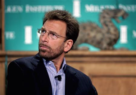 In this file photo Warner Music Group chairman and CEO Edgar Bronfman, Jr. speaks during the ''Media Convergence and the Revolution in Marketing and Brand Building'' session at the 2006 Milken Institute Global Conference in Beverly Hills April 24, 2006. REUTERS/Fred Prouser