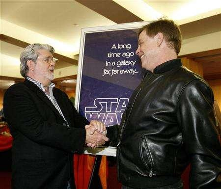 Writer and director George Lucas (L) greets cast member Mark Hamill, who played ''Luke Skywalker'', at the 30th anniversary screening of ''Star Wars'' presented by the Academy of Motion Picture Arts and Sciences in Beverly Hills, California April 23, 2007. The event kicks off the fourth installment of the Academy's ''Great To Be Nominated'' series. REUTERS/Mario Anzuoni