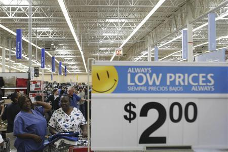 Customers shop at the new 142,000 square foot Wal-Mart store during its grand opening in Chicago in this September 27, 2006 file photo. Wal-Mart has used a myriad of tactics, including some that are illegal, to hinder the ability of its workers to form labor unions, a human rights group said in a report to be released on Tuesday. REUTERS/Joshua Lott/Files