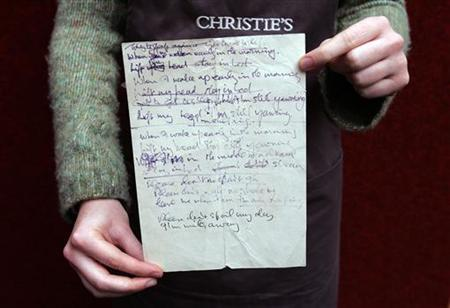 A new music lyrics service launched by Yahoo illustrates the potential and the challenges of integrating lyrics into digital music products today. File photo shows the letter from the GPO (General Post Office) demanding settlement of an unpaid ''radiophone'' bill on the back of which John Lennon wrote the lyrics for the Beatles song ''I'm Only Sleeping'', is demonstrated by a porter at Christie's auctioneers in London September 28, 2005. REUTERS/Stephen Hird